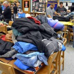 Photo of Kearns High students sorting donated winter clothes