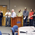 Photo of classified employees being recognized at board meeting