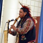 Photo of Native American teacher performing for Oakwood Elementary students