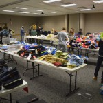 Photo of donated items stacked on tables