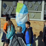 Photo of Rosecrest Elementary students holding hot air balloon