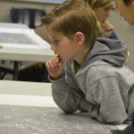 Photo of Vista student surveying map of city