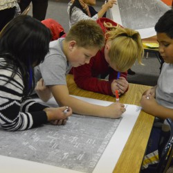 Photo of Vista students marking map of city