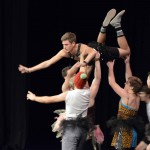 Photo of Cottonwood High students dancing on stage
