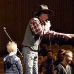Photo of auctioneer speaking at Cottonwood High