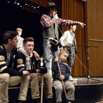 Photo of auctioneer on stage with Cottonwood High SBOs