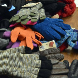Photo of pile of gloves on table