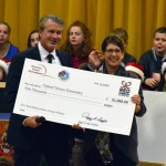 Photo of Upland Terrace principal receiving large check