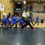 Photo of Kearns High SBO running with kindergarten students
