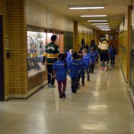 Photo of kindergarteners walking down Kearns High hallway