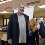Photo of former NFL player posing for photo with Skyline High teacher