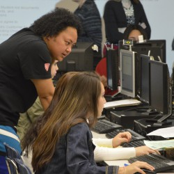 Photo of students completing FAFSA on computers