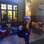 Photo of student dressed as worker at Junior Achievement City