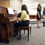 Photo of Cottonwood High singers performing at board meeting
