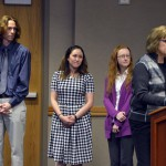 Photo of school counselors being recognized during board meeting