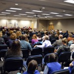 Photo of attendees at board of education meeting