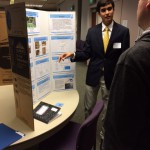 Photo of student explaining science project to judge