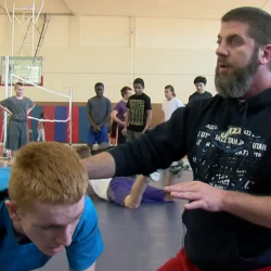 Photo of Brockbank wrestling coach with student