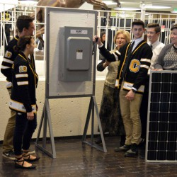 Photo of Cottonwood High SBO flipping switch to solar array