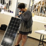 Photo of guest speaker holding solar array at Cottonwood High