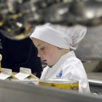 Photo of Future Chefs participant preparing dish