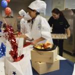 Photo of Future Chefs participant presenting dish