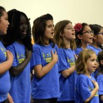 Photo of Hunter Elementary choir reciting Pledge of Allegiance during board meeting
