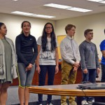 Photo of student athletes being recognized during board meeting