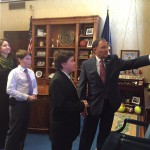 Photo of two Matheson Jr High students speaking with Utah governor