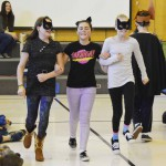 Photo of Oquirrh Hills students acting out scene from book