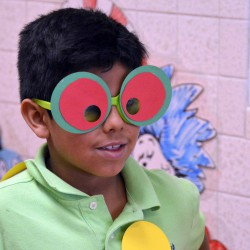 Photo of Oquirrh Hills student wearing comic glasses