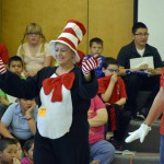 Photo of volunteers dressed as book characters waving to Oquirrh Hills students