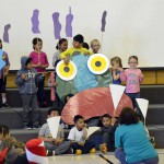 Photo of Oquirrh Hills students telling story with props