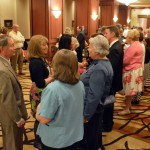 Photo of employees speaking with board members during 25 Year Celebration