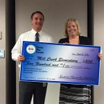 Photo of Mill Creek Elementary principal receiving large check