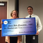 Photo of Silver Hills Elementary principal receiving large check
