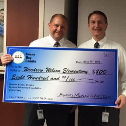 Photo of Wilson Elementary principal receiving large check