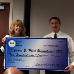 Photo of Moss Elementary principal receiving large check