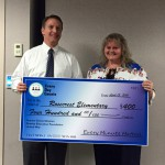Photo of Rosecrest Elementary principal receiving large check