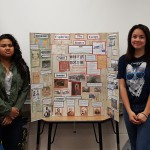 Photo of two students posing with Utah History Day project