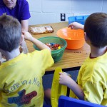 Photo of Whittier Elementary students doing activities on table