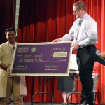 Photo of Granite Park Jr High student receiving large check