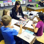 Photo of Upland Terrace Elementary teacher teaching students at table