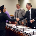 Photo of Sterling Scholar winner shaking hands with superintendent