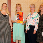 Photo of teacher receiving Sorenson Legacy Award