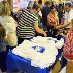 Photo of community members receiving Brockbank Jr High t-shirts