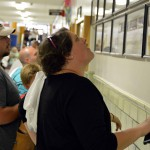 Photo of community members looking at Brockbank Jr High class photos