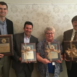 Photo of four administrators receiving awards from GASA