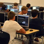 High school students coding in computer lab