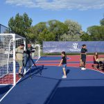 Students walk around RSL mini pitch at Granger Elementary